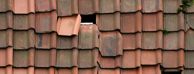 Roof with broken tiles